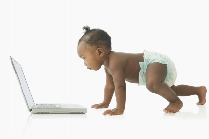 Baby looking at laptop